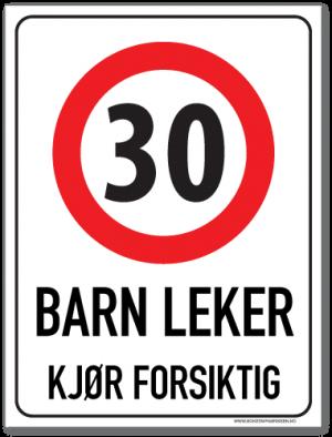 Barn leker skilt med symbol for fartsgrense 30 km/t