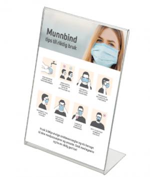skrått bordstativ med informasjon om hvordan man bruker munnbind korrekt