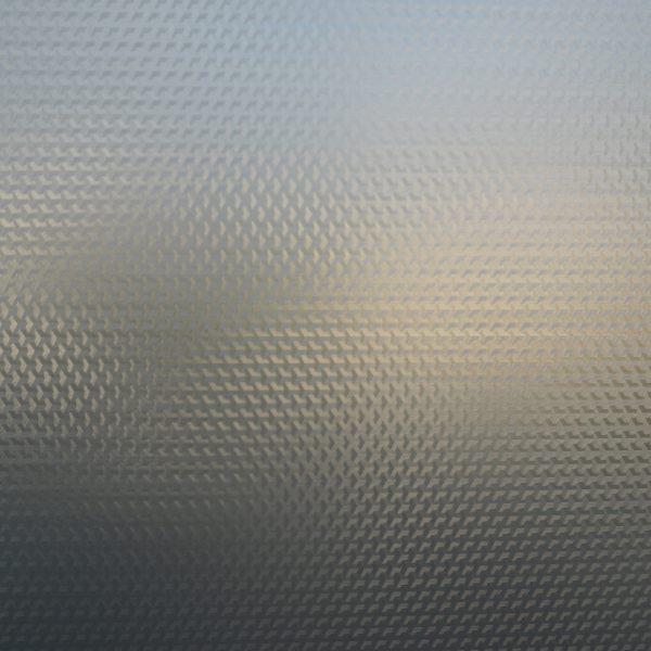 Nærbilde av en vindusfolie med struktur.