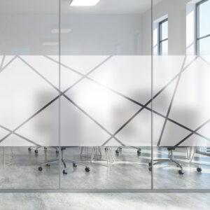 Vindusfolie med abstrakte former montert på glassrute.