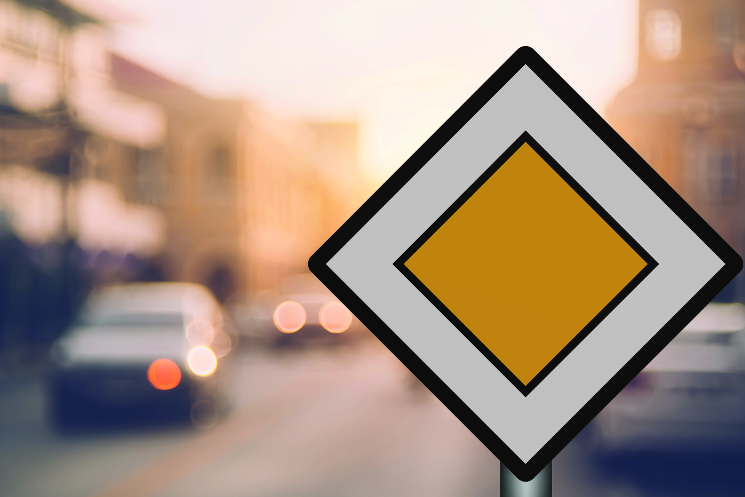 Bilde av et parkeringsskilt plassert ute på gata.
